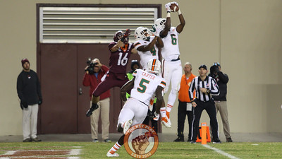 A gaggle of Miami defenders intercept a desperate late-game throw into the endzone for Virginia Tech's third turnover of the game. (Mark Umansky/TheKeyPlay.com)