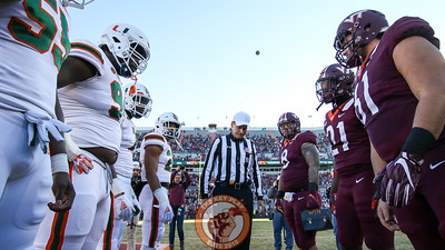 The team captains stand at midfield for the pregame coin toss. (Mark Umansky/TheKeyPlay.com)