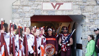 Head coach Justin Fuente stands at the entrance to the tunnel before the team enters Lane Stadium during Enter Sandman. (Mark Umansky/TheKeyPlay.com)