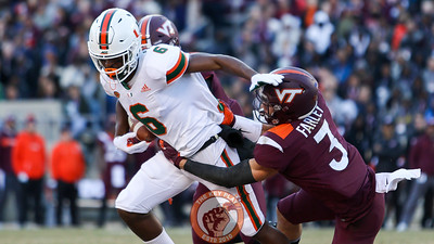 Miami WR Mark Pope attempts to stiff arm Hokies DB Caleb Farley. (Mark Umansky/TheKeyPlay.com)