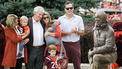 Former Virginia Tech head coach Frank Beamer watches with his family as a statue of himself is unveiled to the public for the first time. (Mark Umansky/TheKeyPlay.com)