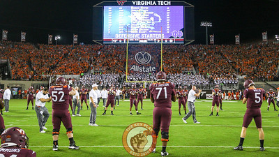 The Hokies warm up on the field as the North Stands quickly fill up well before kickoff. (Mark Umansky/TheKeyPlay.com)