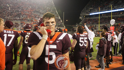 QB Ryan Willis speaks on the phone with the coordinator's booth in the fourth quarter as the Hokies fall behind to Notre Dame. (Mark Umansky/TheKeyPlay.com)