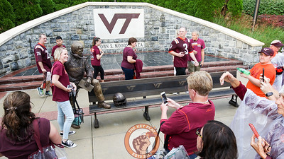 Fans pose next to the newly unveiled Frank Beamer statue outside Lane Stadium. (Mark Umansky/TheKeyPlay.com)