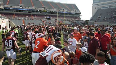 Players sign autographs for fans on the field after the conclusion of the game. (Mark Umansky/TheKeyPlay.com)