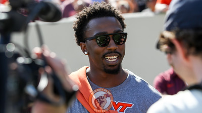 Former Hokies QB and current Cleveland Brown Tyrod Taylor watched the game and addressed the crowd between quarters. (Mark Umansky/TheKeyPlay.com)