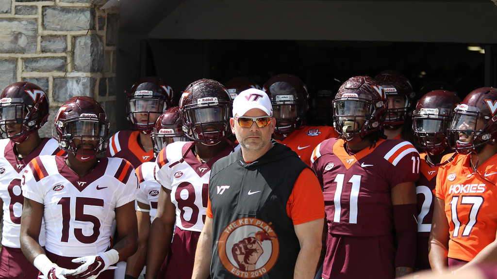 Head coach Justin Fuente stands in front of his players in the entrance to the tunnel into Lane Stadium as Enter Sandman plays. (Mark Umansky/TheKeyPlay.com)