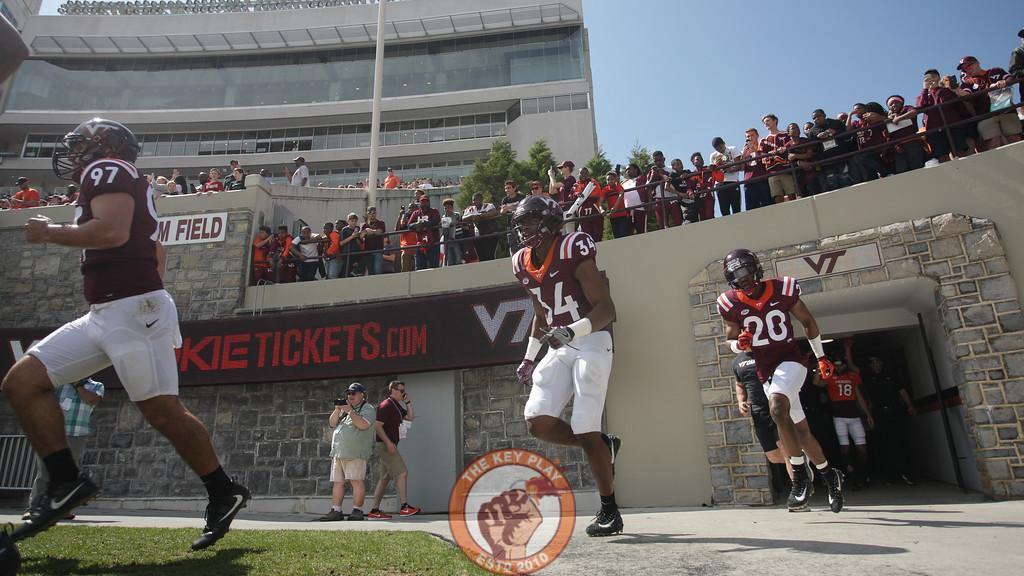 The Hokies take the field to Enter Sandman before the spring game. (Mark Umansky/TheKeyPlay.com)