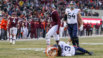 Reggie Floyd walks off after knocking UVa QB Bryce Perkins to the ground after a pass. (Mark Umansky/TheKeyPlay.com)