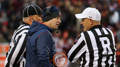 UVa head coach Bronco Mendenhall argues the fumble call with the referees. (Mark Umansky/TheKeyPlay.com)