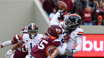 DL TyJuan Garbutt (45) attempts to tackle UVa quarterback Bryce Perkins by his dreadlocks in the first quarter. (Mark Umansky/TheKeyPlay.com)