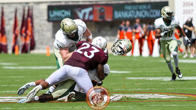 LB Rayshard Ashby tackles William and Mary's Nate Evans and forces his helmet to fly off. (Mark Umansky/TheKeyPlay.com
