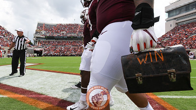 DL Ricky Walker carries the Virginia Tech Lunchpail with him as the captains walk to midfield for the coin toss. (Mark Umansky/TheKeyPlay.com