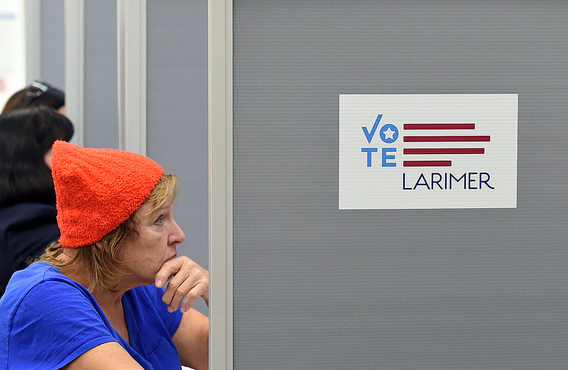Brenda Mutchler of Loveland casts her ballot on one of the electronic voting machines Tuesday, Nov. 6, 2018, at the vote center in the Loveland Police and Courts Building.   (Photo by Jenny Sparks/Loveland Reporter-Herald)