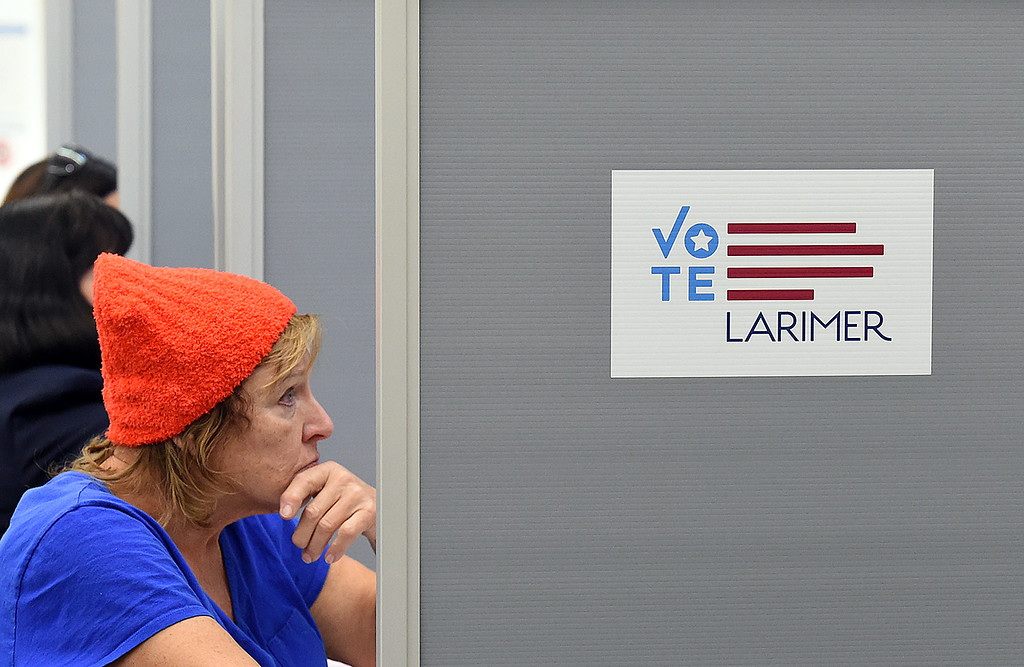 . Brenda Mutchler of Loveland casts her ballot on one of the electronic voting machines Tuesday, Nov. 6, 2018, at the vote center in the Loveland Police and Courts Building.   (Photo by Jenny Sparks/Loveland Reporter-Herald)
