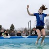 Annie Schafer, 18, from Dover MA shows on her face how cold the water is as her feet touch the water during her participation in the 2018 Wachusett Polor Dip to raise money for Camp Sunshine at Wachusett Mountain Ski Area in Princeton on Saturday, March 10, 2018. The event raised over $50,000 dollars for the camp. SENTINEL & ENTERPRISE/JOHN LOVE