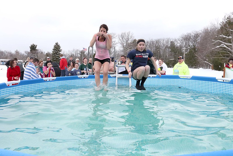 Katyelyn Henrie, 34, and McKenna Priest, 14, both of Leominster take part in the 2018 Wachusett Polor Dip to raise money for Camp Sunshine at Wachusett Mountain Ski Area in Princeton on Saturday, March 10, 2018. The event raised over $50,000 dollars for the camp. SENTINEL & ENTERPRISE/JOHN LOVE