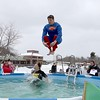 Anthony Callahan, aka Superman, and his wife Erica Callahan from Ashburnham leap into the freezing cold water during the 2018 Wachusett Polor Dip to raise money for Camp Sunshine at Wachusett Mountain Ski Area in Princeton on Saturday, March 10, 2018. The event raised over $50,000 dollars for the camp. SENTINEL & ENTERPRISE/JOHN LOVE