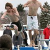Gabe Sennott and Lance Jarosz from Harvard leap into the freezing cold water during the 2018 Wachusett Polor Dip to raise money for Camp Sunshine at Wachusett Mountain Ski Area in Princeton on Saturday, March 10, 2018. The event raised over $50,000 dollars for the camp. SENTINEL & ENTERPRISE/JOHN LOVE