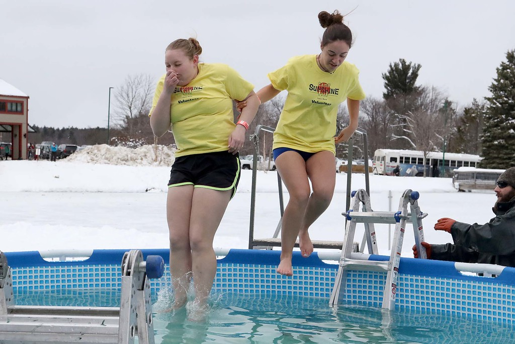 . Kiersten Laromee, 18, and Nicole Sterste, 17, from Belchertown were the last two into the freezing cold water during the 2018 Wachusett Polor Dip to raise money for Camp Sunshine at Wachusett Mountain Ski Area in Princeton on Saturday, March 10, 2018. The event raised over $50,000 dollars for the camp. SENTINEL & ENTERPRISE/JOHN LOVE