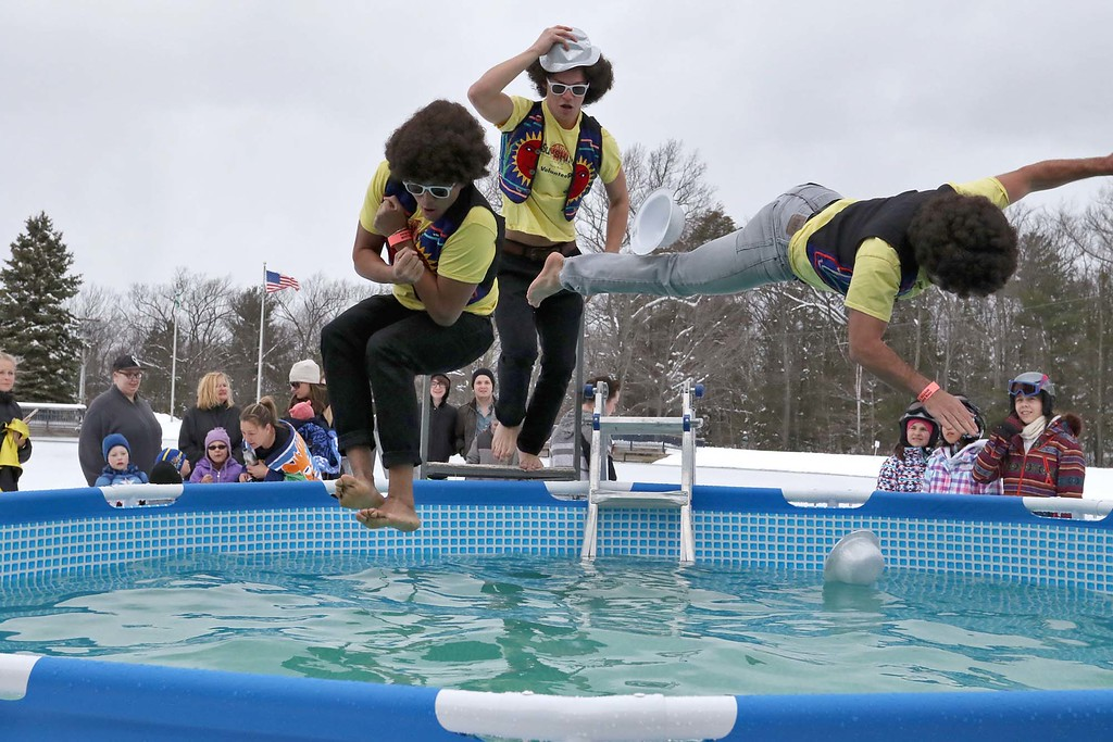 . Friends Ryan Heng, 18, Henry Higgins, 18, and their North Hampton High School technology teacher Jeromie Whalen, 30, got all dressed up for the 2018 Wachusett Polor Dip to raise money for Camp Sunshine at Wachusett Mountain Ski Area in Princeton on Saturday, March 10, 2018. The event raised over $50,000 dollars for the camp. SENTINEL & ENTERPRISE/JOHN LOVE