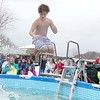 Kyle Fisher, 13, is still in the air as he is hit by a splash from his friend Zach Consalvo, 10 both from Leominster, as they participate in the 2018 Wachusett Polor Dip to raise money for Camp Sunshine at Wachusett Mountain Ski Area in Princeton on Saturday, March 10, 2018. The event raised over $50,000 dollars for the camp. SENTINEL & ENTERPRISE/JOHN LOVE
