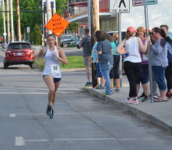 John Brewer - Oneida Daily Dispatch Runners and walkers take part in the 19th annual Wilber-Duck Mile in the city of Oneida on Friday, May 18, 2018.
