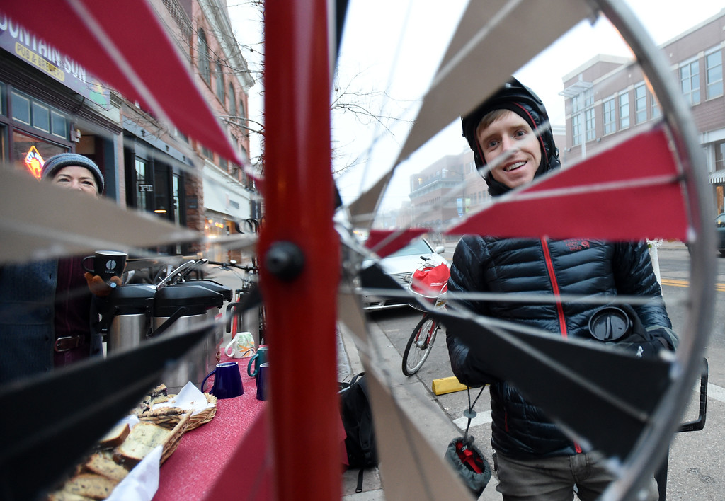 . Connor Felletter, right, spins a wheel for a prize at ThE Cup food station. Wendy, Ball, left, is running the station. Friday was Winter Bike to Work Day in Boulder County. For a video and gallery, go to dailycamera.com. Cliff Grassmick  Photographer  February 9, 2018