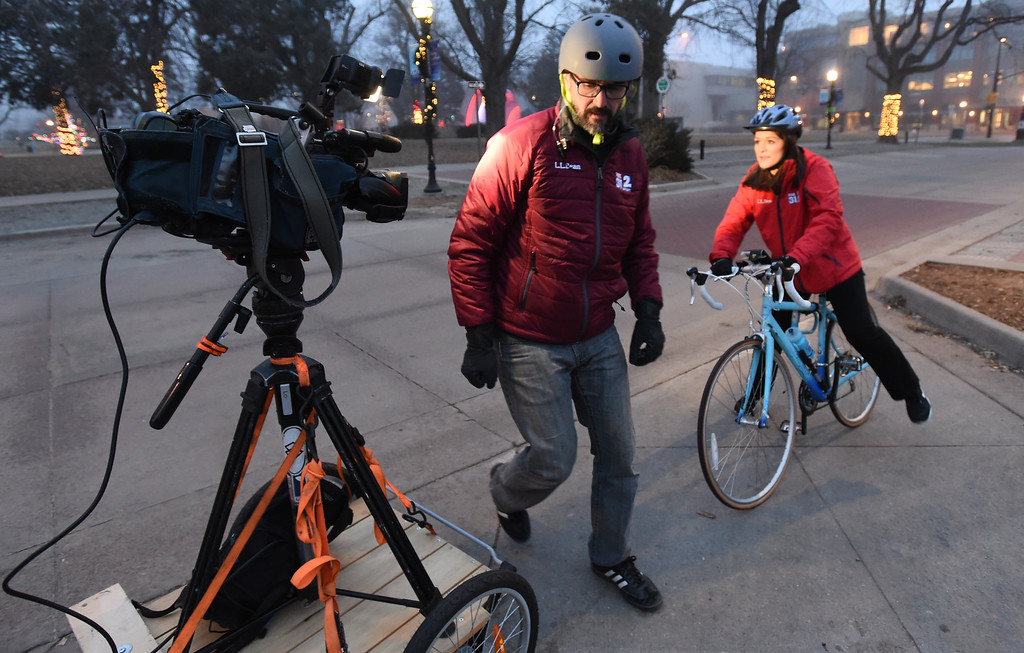 . Cody White, left, and Christine Rapp, both of Channel 2 Denver, have a camera on a trailer behind a bike to film Christine on another bike. Friday was Winter Bike to Work Day in Boulder County. For a video and gallery, go to dailycamera.com. Cliff Grassmick  Photographer  February 9, 2018