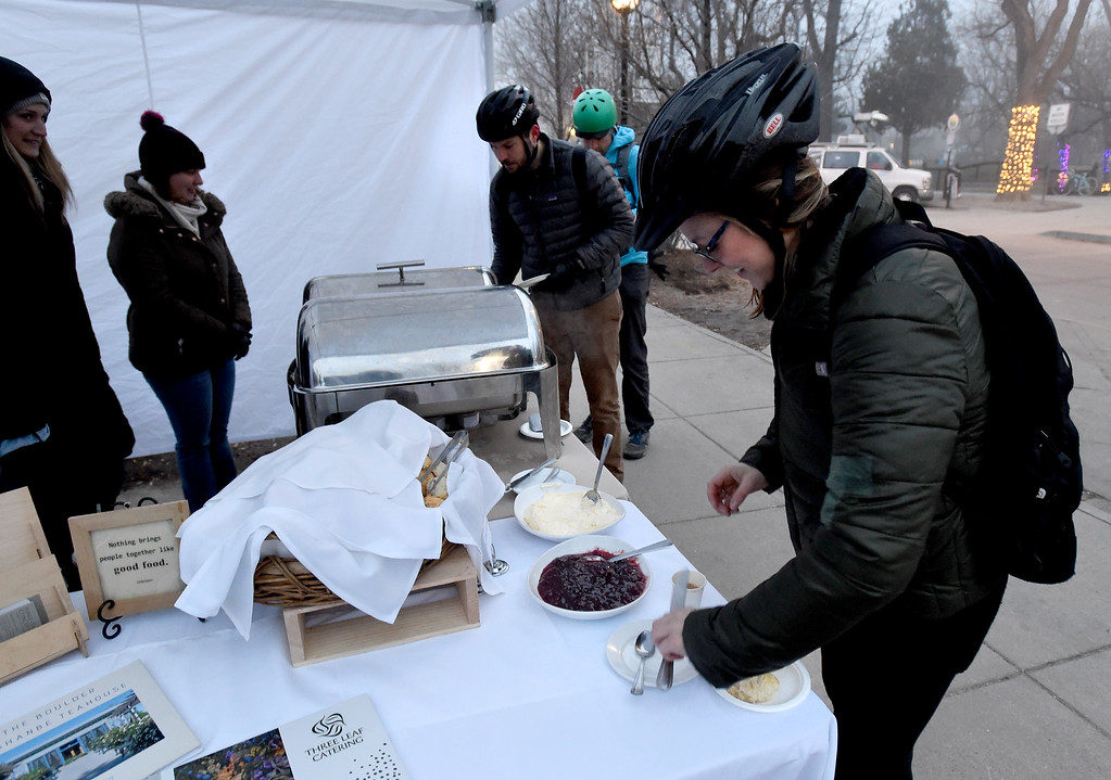 . Alex Kessler, right, gets breakfast at the Dushanbe Teahouse food station. Friday was Winter Bike to Work Day in Boulder County. For a video and gallery, go to dailycamera.com. Cliff Grassmick  Photographer  February 9, 2018