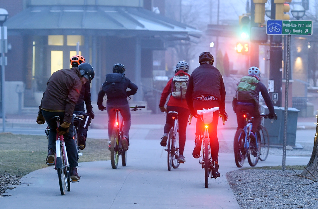 . Riders take off from a food station near Central Park in Boulder. Friday was Winter Bike to Work Day in Boulder County. For a video and gallery, go to dailycamera.com. Cliff Grassmick  Photographer  February 9, 2018