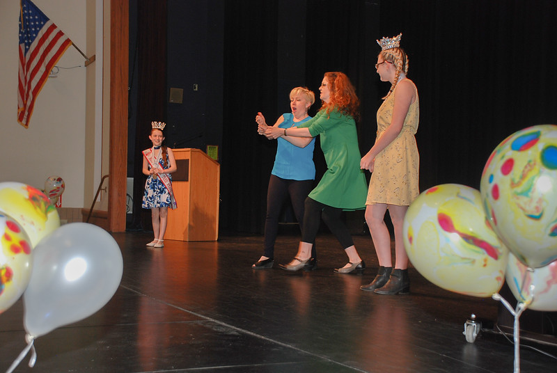 Youth Volunteers Anglee Brewer and Kallee Parent volunteer to assist the actors, Jen and Amy, on stage