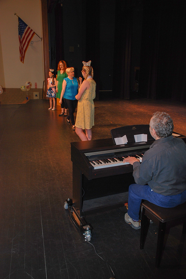Youth Volunteers Anglee Brewer and Kallee Parent volunteer to assist the actors, Jen and Amy, on stage while Larrance plays piano