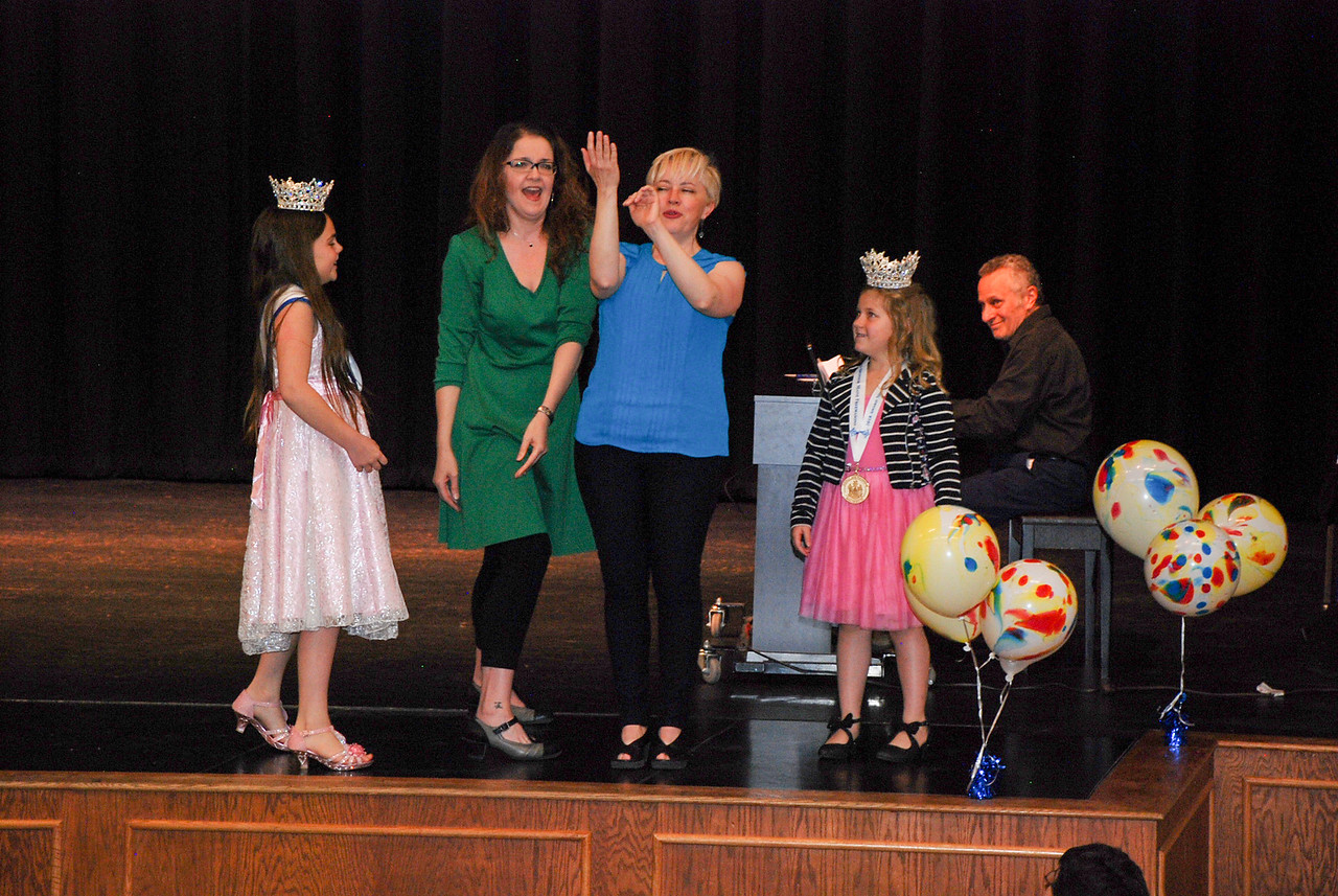 Youth Volunteers Peyton Rollins and Heaven Luce volunteer to assist the actors, Jen and Amy, on stage