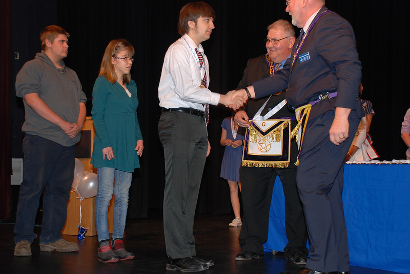 Youth volunteer Marcus Vaillancourt accepts his award