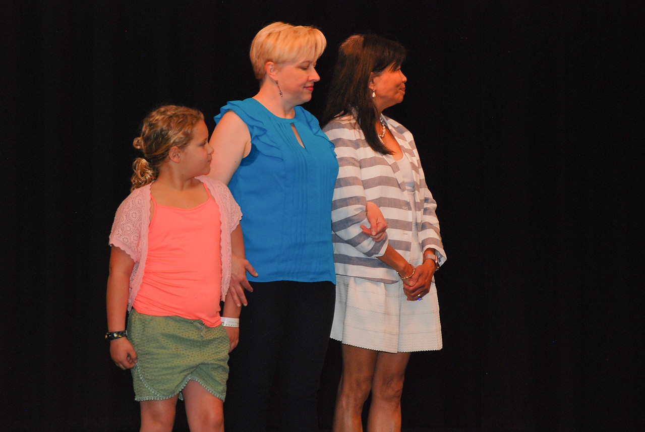 Quinn Rollins and Annie Bossong assist Jen on stage