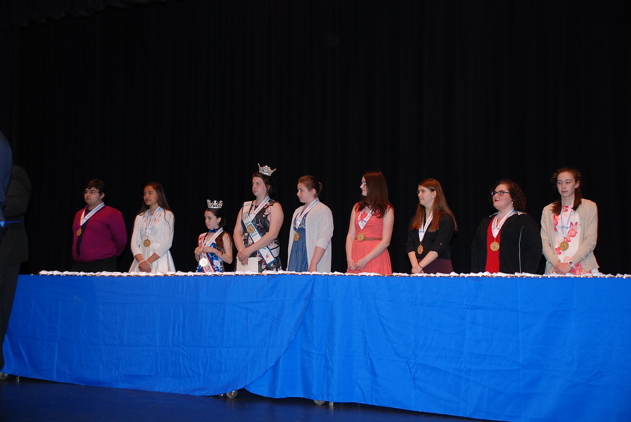 Youth volunteers accept their awards