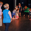 Youth volunteers assist actors on stage
