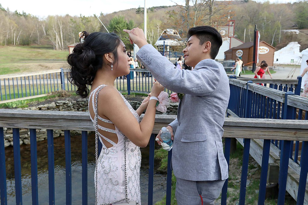 . Fitchburg High School Prom was held at Wachusett Mountain in Princeton on Saturday night, May 5, 2018. Dylan Thanadabouth helps out his date Sehda Kong with a hair issue at the prom. SENTINEL & ENTERPRISE/JOHN LOVE