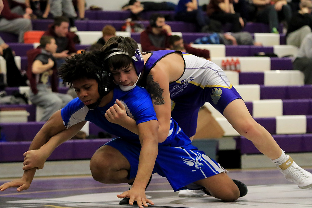 . John Applin Memorial Wrestling Tournament Was held at Montachusett Regional Vocational Technical School on Saturday morning, December 22, 2018. Monty Tech\'s freshman Colin Dudek wrestled Worcester Technical High School\'s sophomore Issiah Bryant, in blue. SENTINEL & ENTERPRISE/JOHN LOVE