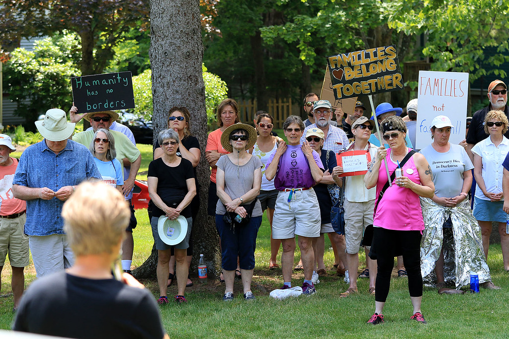 ". Community members in Lunenburg held a ""Children Belong Together\"" at the gazebo in town on Saturday. People at the event listen to the speakers. SENTINEL & ENTERPRISE/JOHN LOVE"