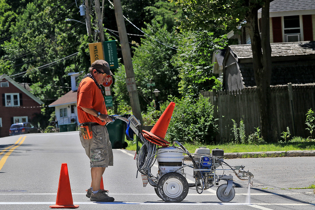 . The Head of the Traffic Department at the DPW in Fitchburg Mike East paints the lines on North Street in Fitchburg Friday morning using their two year old LineLaser 3400. They have another machine but it is 30 years old. SENTINEL & ENTERPRISE/JOHN LOVE