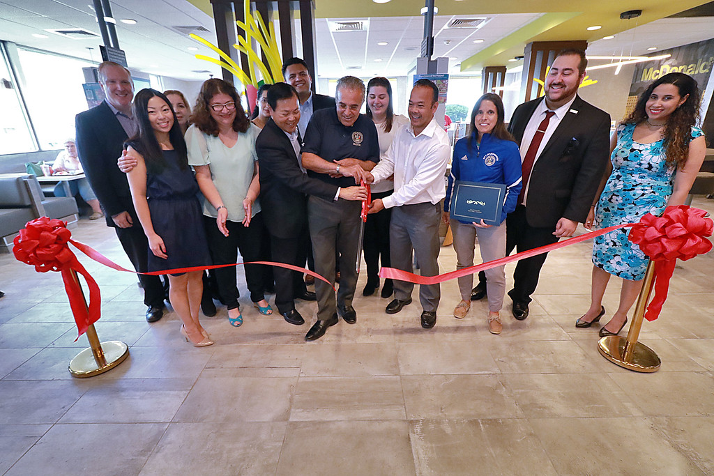 . McDonald�s held a ribbon cutting for their newly remodeled North Main Street location on Friday morning. Cutting ribbon is Owner David Yee, Leominster Mayor Dean Mazzarella and Senator Dean Tran. SENTINEL & ENTERPRISE/JOHN LOVE