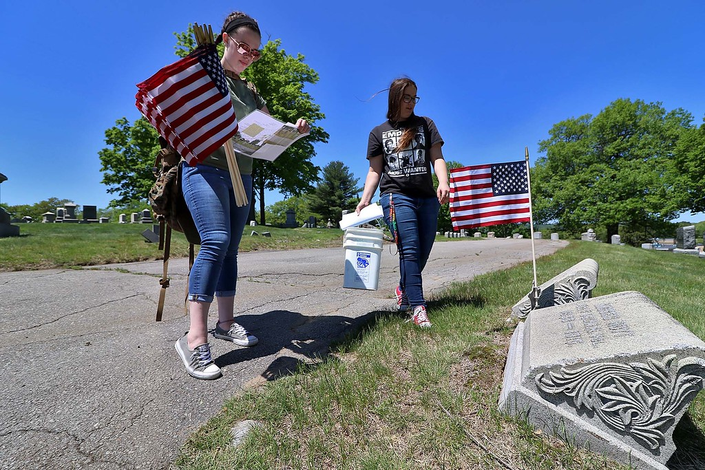 . Montachusett Regional Vocational Technical School Marine Corps JROTC Cadets Sgt. Katie Wade and Corporal Mollie DeCosta look over the map they where given to find the veterans graves at Forest Hill Cemetery in Fitchburg on Thursday morning so they could put flags on them for Memorial Day. SENTINEL & ENTERPRISE/JOHN LOVE