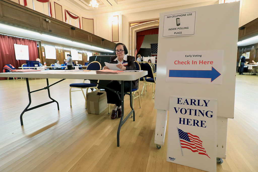 . Early voting has started at Leominster City Hall this week. Election official Doris Decicco helped voters check what precinct they would have voted in as they came to vote early. SENTINEL & ENTERPRISE/JOHN LOVE
