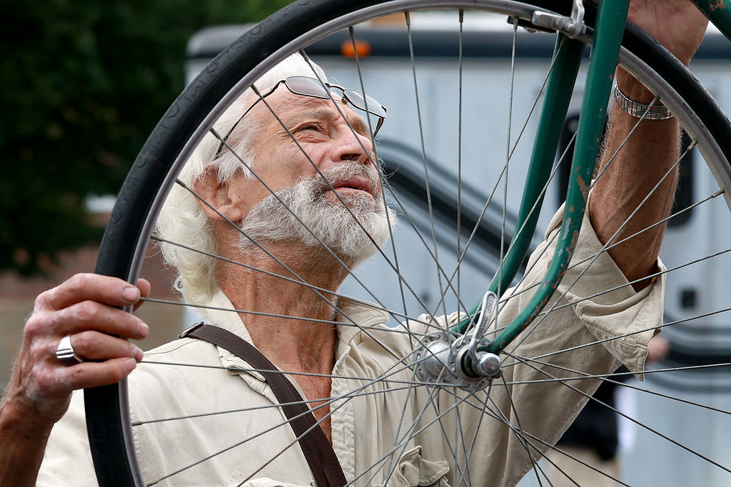 . The Annual Fitchburg Rides event was held in the parking lot in front of River Styx on Boulder Drive Saturday, June 23, 2018. Barry Slome of Fitchbnurg checks out one of the vintage bike for sale at the event. SENTINEL & ENTERPRISE/JOHN LOVE