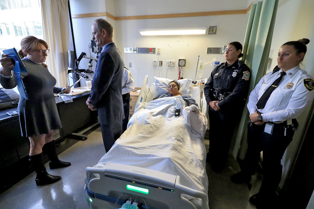 . Wanda Liz Gonzalez of 35 Wanoosnoc Road was arraigned in her hospital bed at UMass Memorial Hospital in Worcester, November 7, 2018. Her Attorney John Swormley talks to the judge by way of a computer tablet held by sessions clerk Erin O\'Connell. SENTINEL & ENTERPRISE/JOHN LOVE