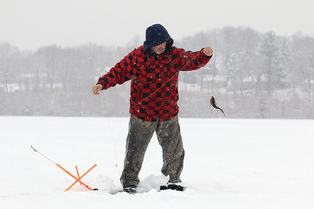 . A little snow and temperatures in the low 30\'s did not stop Bruce Maki of Fitchburg from getting out on the ice at Lake Whalom to a little ice fishing. He caught a nice yellow belly perch while out fishing on Wednesday afternoon. SENTINEL & ENTERPRISE/JOHN LOVE