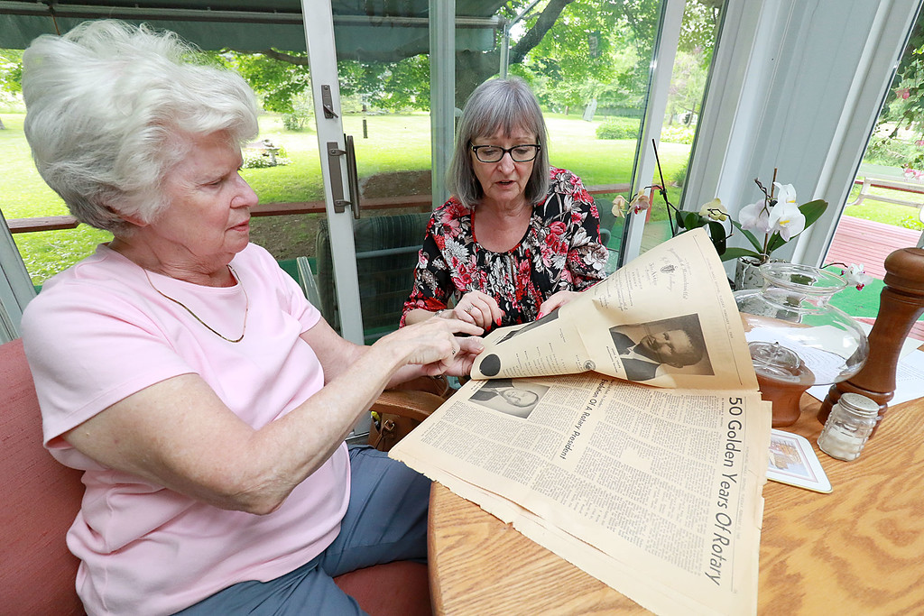 . Fitchburg Rotary Club is celebrating 100 years Members of the club talked about their up coming celebration on Friday afternoon. Members Mary Whitney and Karen Fusco look over a pull out that the Sentinel & Enterprise put out for the clubs 50th celebration. SENTINEL & ENTERPRISE/JOHN LOVE