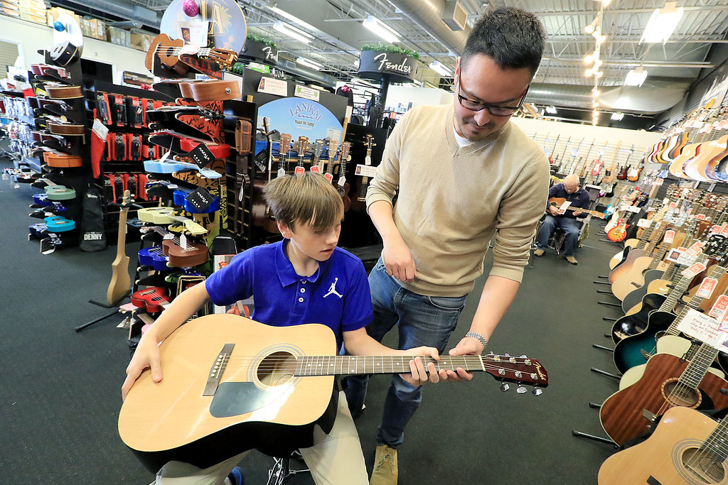 . Small Business Saturday was held this year on November 24, 2018. Many businesses in the North Central region participated in the event to help people shop local. Nick Doyen of Leominster helps his step son Joe James, 12, try and figure out which instrument he wanted to by. SENTINEL & ENTERPRISE/JOHN LOVE
